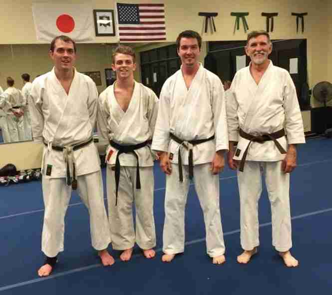 Two generations of adult karate students, the Guillemets and the McCormacs.